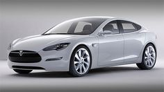 Tesla model S. Features include (taking deep breath) a 17-inch infotainment touchscreen with all-time 3G connectivity, 21-inch wheels, Brembo brakes, panoramic roof with sliding moon roof, retracting door handles...