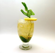 The Summertime Smash 1 ounce Frangelico 1 ounce bourbon (I used Buffalo Trace)  1 teaspoon sweetener of choice (granulated sugar, simple syrup, or mint-steeped simple syrup; see Tasting Notes below for recipes and tips) A splash of two lemon-spiked seltzer  About 8 large mint leaves Crushed ice Mint sprig and lemon wheel, to garnish