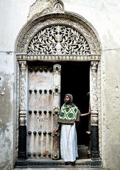 Veiled woman in front of a door in Stone Town, Zanzibar, Tanzania by Eric Lafforgue Eric Lafforgue, Small World, Cap Vert, Muslim Culture, Stone Town, Africa Travel, Doorway, Windows And Doors, Front Doors