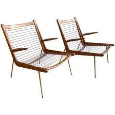 Pair of Peter Hvidt & Orla Mølgaard Nielsen Boomerang Chairs | From a unique collection of antique and modern lounge chairs at http://www.1stdibs.com/furniture/seating/lounge-chairs/