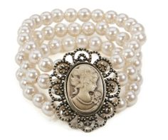 Three strand glass pearl bracelet with a vintage style cameo in centre