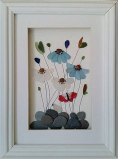 A truly unique gift for Mothers Day - or any special occasion. Stained Sea Glass Flowers set inside a 26cm x 35cm glazed box frame that is available in either black or white. The delicate petals of these flowers have been created using genuine ocean tumbled shards of beautifully