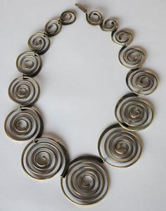 """Art Smith Necklace, brass. ca.1950's. One of the leading modernist jewelers of the mid-twentieth century, Smith trained at Cooper Union. Inspired by surrealism, biomorphicism, and primitivism, Art Smith's jewelry is dynamic in its size and form. Although sometimes massive in scale, his jewelry remains lightweight and wearable. See """"From the Village to Vogue: The Modernist Jewelry of Art Smith""""."""