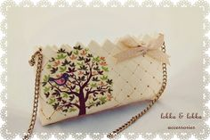 Handmade bag from paper with decoupage and chain.