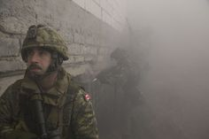 Canadian soldier coordinates entering a building with Polish soldiers (background) during a joint urban training activity at the Pomorksie Drawsko training range in Poland during Operation REASSURANCE [5427x3648]