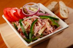 Swiss-style ham & cheese salad  - julienne-sliced ham and cheese with onions, peppers, tomatoes, vinegar & oil