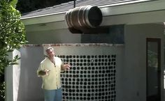 This winery-inspired outdoor shower includes 450 glass bottles as well as an oak barrel. Click through to watch the video showing how it was done!