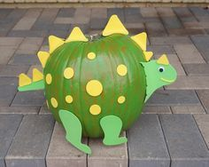 Easy to do pumpkin craft. Simply paint your pumpkin and use foam stickers to decorate it any way you want! We made a dinosaur!