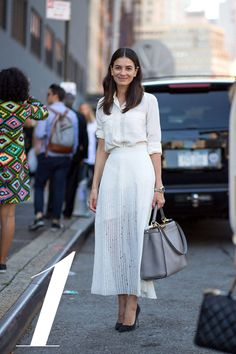 """Approach: """"I tend to streamline as much as possible and build a fashion month wardrobe around a few key pieces, from seasons past and present, that will take me through from day to evening.""""   - HarpersBAZAAR.com"""