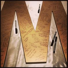 Client submitted photo of their giant letter M wedding guestbook! We painted it a beautiful gold metallic color and it was ready for signatures! #wedding #reception #weddingguestbook #gold #giantletter #etsy #matchpointgifts#event #eventdecor#eventstyling