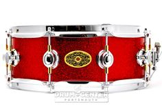 "Montineri Custom WFL Hybrid Mahogany Snare Drum 14x5 Vintage Red Sparkle 5x14 Vintage ""WFL Hybrid Custom Order"" Snare - Vintage Mahogany Shell w/ Back-Cut Balanced ReRings, Vintage Red Sparkle Finish, 10 HD Oval Lugs, HD Piccolo Throw, Cast Butt, 2.3mm Hoops, 20-Strand German Snare Wires/SS Cord. Purchase Here: http://www.drumcenternh.com/montineri-custom-wfl-hybrid-mahogany-snare-drum-14x5-vintage-red-sparkle.html"