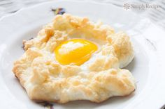 "Egg nest! Also called an ""egg on a cloud."" Egg whites are first whipped into a meringue, baked, and then baked a little longer with the egg yold nestled in the middle. Yum!"