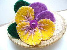 Yellow and purple felt flower pin is inspired by the spring pansies.    A flower brooch is handmade to order in light purple and yellow felt with