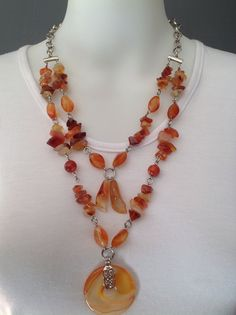 Double strand gemstone necklace with Carnelian chips and twist beads, carnelian Lillies and donut pendant - Michela Rae