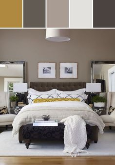 Warm colors with comfy linens make this bedroom amazing and inviting.  You have to love the two oversized framed mirrors.  Nicely done.