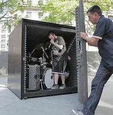 Death metal band Unfathomable Ruination playing inside a soundproof metal box in London