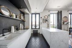 Elegant and minimalist kitchen design with white color.