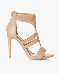 Give your lower half it's own spotlight. The elegant braids on these T-strap heeled sandals perfectly accentuate your legs and freshly polished toes.