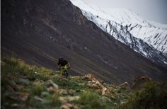 Matt Hunter dwarfed by the snowy Pamir mountains. We make the most of the times we can ride, rather than carry, our bikes.