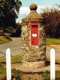 Historic British post boxes. From 1857 post boxes began appearing in walls, buildings and brick pillars. This pillar-mounted wall box in Buckinghamshire dates from the 1870s.