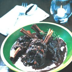 At the restaurant, orzo (rice-shaped pasta) is served alongside the gravy-rich lamb.