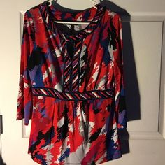 "BCBGMaxazria top from Saks Fifth Avenue About 28"" long from shoulder to hem. Lightweight. 93% rayon. 5% spandex. Gently used. Like new. Very flattering BCBGMaxAzria Tops"