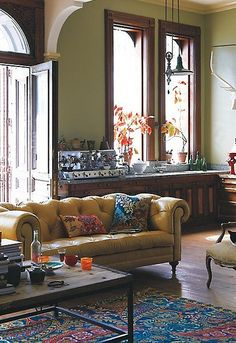 Despite not having wood trim in the sunroom, mix of styles and seating is fun.  Anthropologie {eclectic bohemian traditional vintage modern living room} by recent settlers, via Flickr
