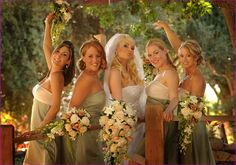 all girl have cascade of soft peach rose and orchids to match their celedon dresses