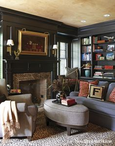 Designer Charlotte Barnes in New England Home.  (Hello Anon. I'm afraid all that is said about the walls is that they are black-lacquered. You can check it out here. Best, G)