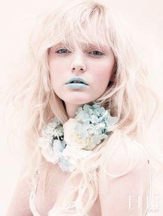 Minty-blue lipstick. So feminine!