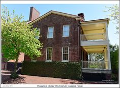 Verandahs adorn the 1765 Ridout Carriage House in Annapolis Maryland. Photograph published on June 22nd 2015. To see a full size version of this photograph and the Annapolis Experience Blog article click on the Visit Site button. Image and article Copyright © 2015 G J Gibson Photography LLC.