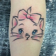 So stinkin' cute. I love this Marie tattoo.