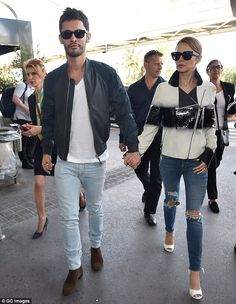 Cheryl teamed the bold fashion statement with ripped denim jeans and large designer shades. Great look