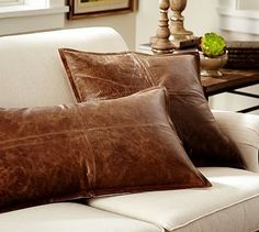 Pieced Leather Pillow Cover. These feel a bit heavy but I like the sophistication and weathered look and mix of textures with softer pillows.