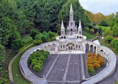 Basilique de Lourdes - Elancourt, France - Photo © Philippe Guillard - The Basilica of Immaculate is commonly named the 'upper Basilica'. Designed by the architect Violet Le Duc, the construction was started in 1866 and finished in 1887. It is built 20 meters high on the rocks above the grotto of the apparitions and the spring.   #Church #Architecture #Photography #Places #Travel #France  