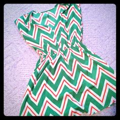 """Cute short dress Green, white and orange chevron pattern dress. A-line style with elastic at the waist and pockets. It also features buttons on the front that are decorative. It hits a little above mid thigh on me and I'm almost 5'4"""". Wore it once and it looks great with a thin metallic belt and sandals! Smoke and pet free home. Dresses Mini"""