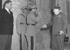 The Shah of Iran saluting Winston Churchill on the occasion of Churchill's 69th birthday at the close of the Tripartite Conference of Tehran, November 1943. On the far left is Ali Soheili, serving his second term as Prime Minister of Iran. The picture was taken by the Iranian press. Churchill is shown wearing his honorary air commodore's uniform.