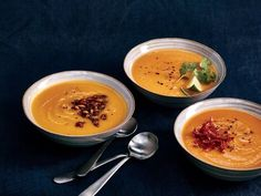 Even without added cream, this pumpkin soup takes on a luxuriously velvety texture after it's simmered and pureed. The combination of red curry paste, ginger, and coconut milk result in a Thai-inspired meal. Make sure all the ingredients are very tender so they'll blend together smoothly. Simple toppings like salty-sweet pepitas make them a little more special. For a fun, no-fuss garnish, top with 2 tablespoons popped popcorn. Other topping options include fried onions and garlic, chopped…