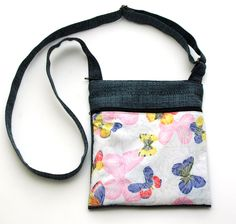 Soft Pastels Butterfly Sling Bag  AUD49.00 100% cotton quilting fabric with soft pastel butterflies. Its got a front zipper pocket for easy access to keep all your keys, cards etc. The main bag has also zip. Inside is fully lined with 4 pockets! 1 zipped and 3 smaller pockets to put your cellphone or smaller stuff in. Comes with fully adjustable straps.   Dimensions: 21.5cm (wide) X 25cm (tall) http://www.imusthavethat.com.au/pd-soft-pastels-butterfly-sling-bag.cfm
