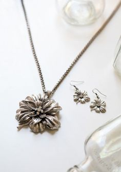 I love this flower long pendent.  In fact I might just order it today.  Perfect touch of spring in winter....