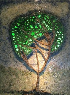 Recycled pulped paper, broken glass, hemp, copper with a resin coat and LED lights.