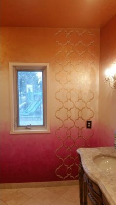 Gold trellis hand painted over rose gold,  cream, and magenta ombre wall treatment by Lezley Lynch Designs, Edmond, OK