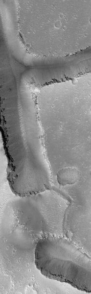 Cracked Mars August 14, 2013 This Mars Global Surveyor (MGS) Mars Orbiter Camera (MOC) image shows v-shaped troughs in the Hephaestus Fossae region of Mars.