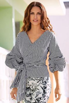 Add a little drama to your summer wardrobe with our poplin gingham top styled with a self-tie wrap and dramatic ruched sleeves. Cotton/polyester Imported Machine wash