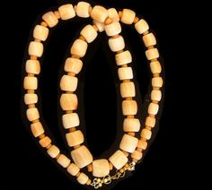 "Conch shell ""white coral"" necklace with small coral beads from the West African bead trade, these beads were made between 1775 and 1925. 28"" /495"