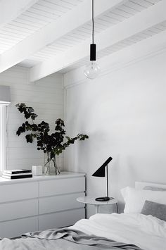 white furniture The bedroom upholds the simple, monochrome aesthetic, with black accents complementing white paint and furniture Monochrome Bedroom, Modern Bedroom, Minimal Bedroom Design, Monochrome Interior, Bedroom Simple, White Furniture, Plywood Furniture, Furniture Design, Furniture Stores
