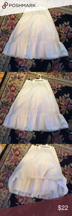 Vtg White flouncy crinoline White crinoline with elastic waist and hook & eye lace trim on him stiff nettingon the bottom ruffle13 inch waist with a little more give the length is 27 inches hope that helps Vintage Intimates & Sleepwear