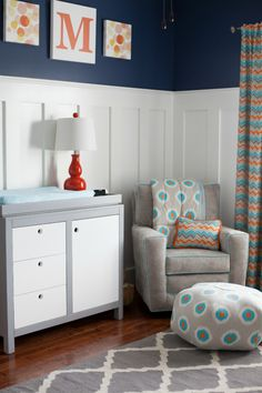 We can't get enough of this ikat pouf and over-the-glider throw in this modern boy nursery!