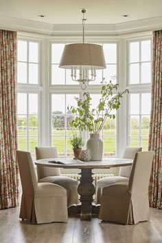 A beautiful round dining table and chairs with covers in front of bay window looking out in the fields. The traditional English Home by Sims Hilditch The Old Farmhouse Dorset Interior Design Lights Over Dining Table, Dining Nook, Dining Table Chairs, Round Dining Table, Farmhouse Interior, Farmhouse Furniture, Luxury Interior Design, Interior Architecture, Classical Architecture