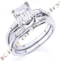 This sparkling and elegant asscher cut diamond Bridal Ring & Band Set carries a total weight of 1.75 Cts, with center stone weighing 1.01 carats. All Diamond are 100% natural and real, never been enhanced or treated in anyway. The diamonds are set in a beautiful high polished 14K white or yellow gold or 18K white or yellow gold or platinum setting. They come in E Color (Extreme Fire & Shine), VS1 clarity. This Bridal Ring & Band Set will definitely make any of your loved ones feel special.